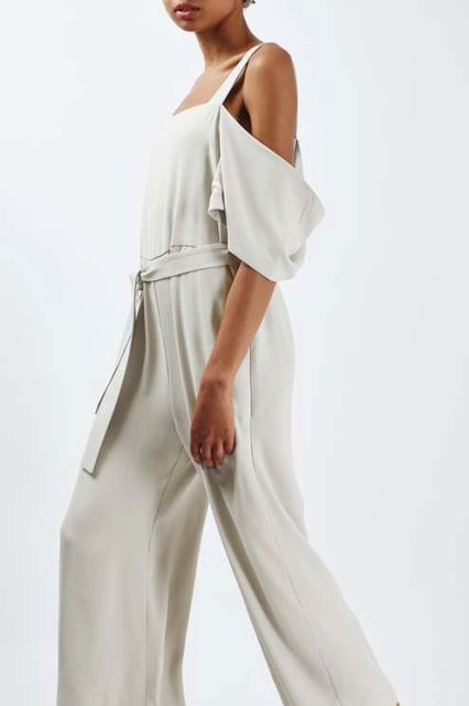 White jumpsuit with fabric belt
