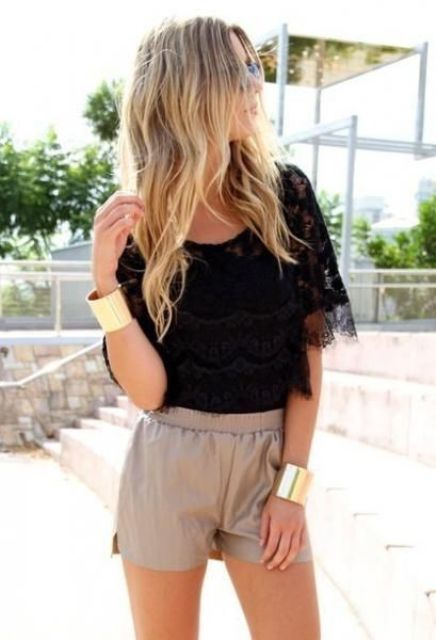 With black lace shirt and bracelets