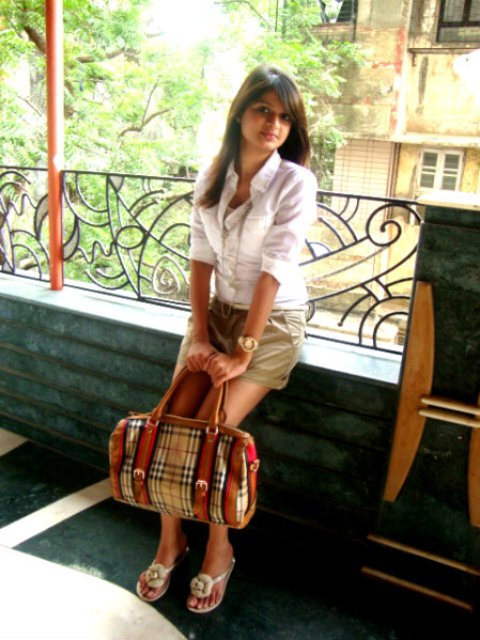 With classic white blouse and printed bag