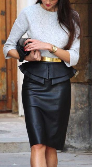 With gray shirt, gold belt and clutch