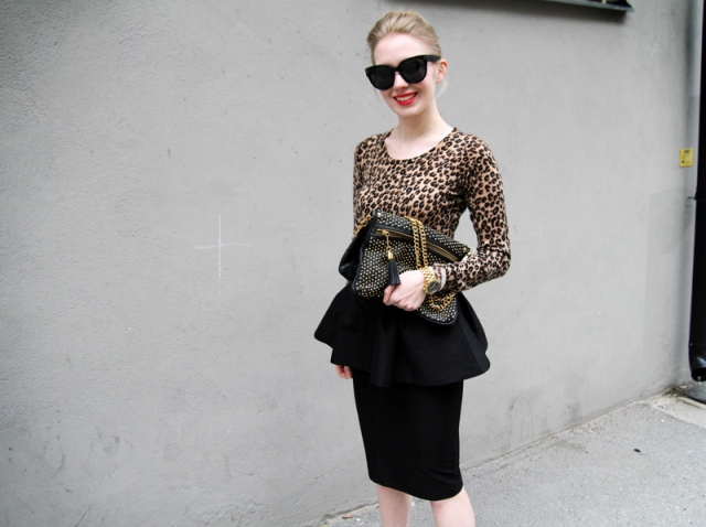 With leopard shirt and bag