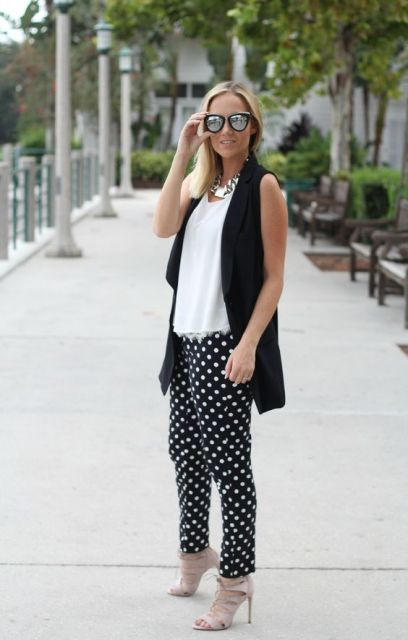 With long black vest and heels