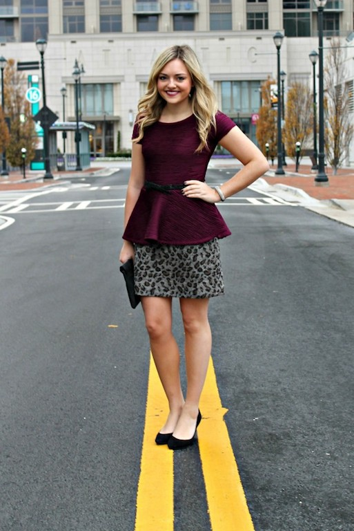 With printed skirt, black shoes and clutch