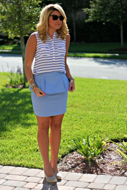 With sleeveless striped top and neutral shoes