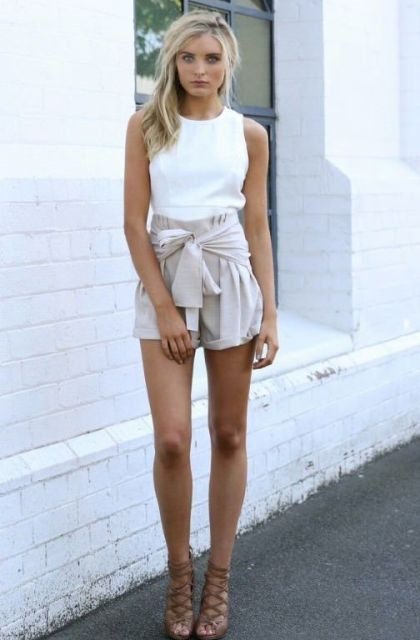 With sleeveless top and lace up heels