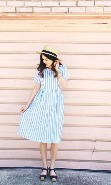 With straw hat and blue flat sandals