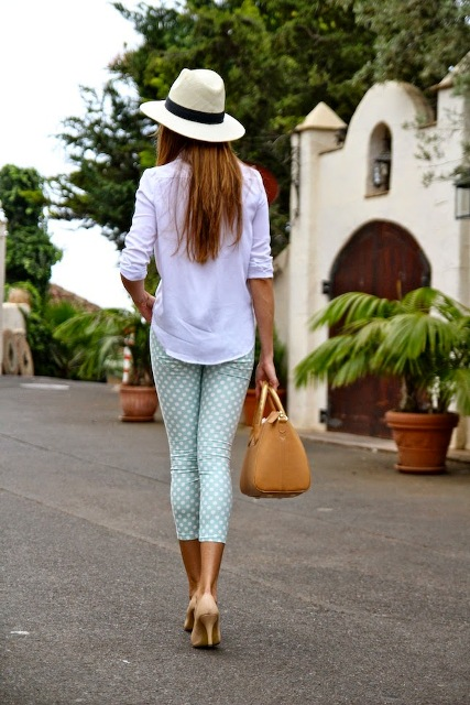 With straw hat, white blouse and heels