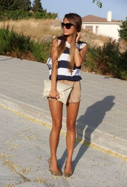 With striped shirt and clutch