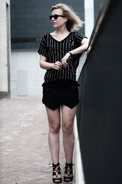 With striped shirt and lace up heels