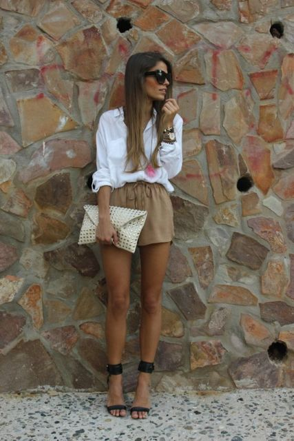 With white loose blouse and heels