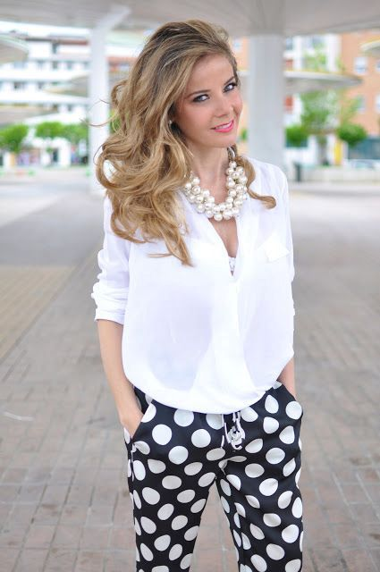 With white loose blouse and statement necklace