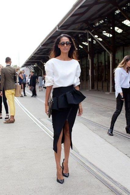 With white shirt and classic black pumps