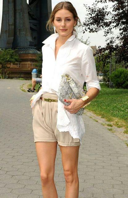 With white shirt and metallic belt