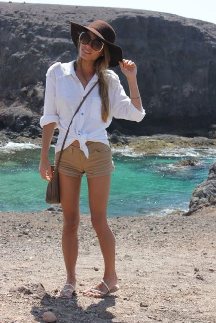 With white shirt, wide brim hat and flat sandals