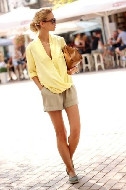 With yellow wrap blouse and flats