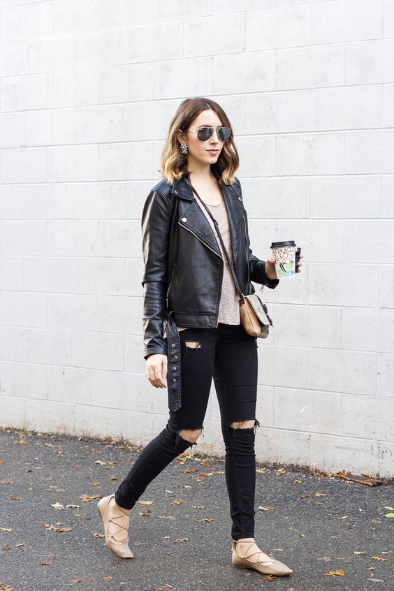 a black leather jacket, black skinnies, a nude top and nude flats