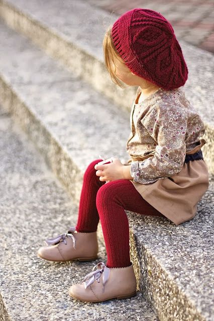 a brown floral shirt, a brown skirt, red leggings, brown boots