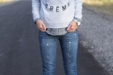 02 a graphic sweatshirt, a checked shirt and blue denim