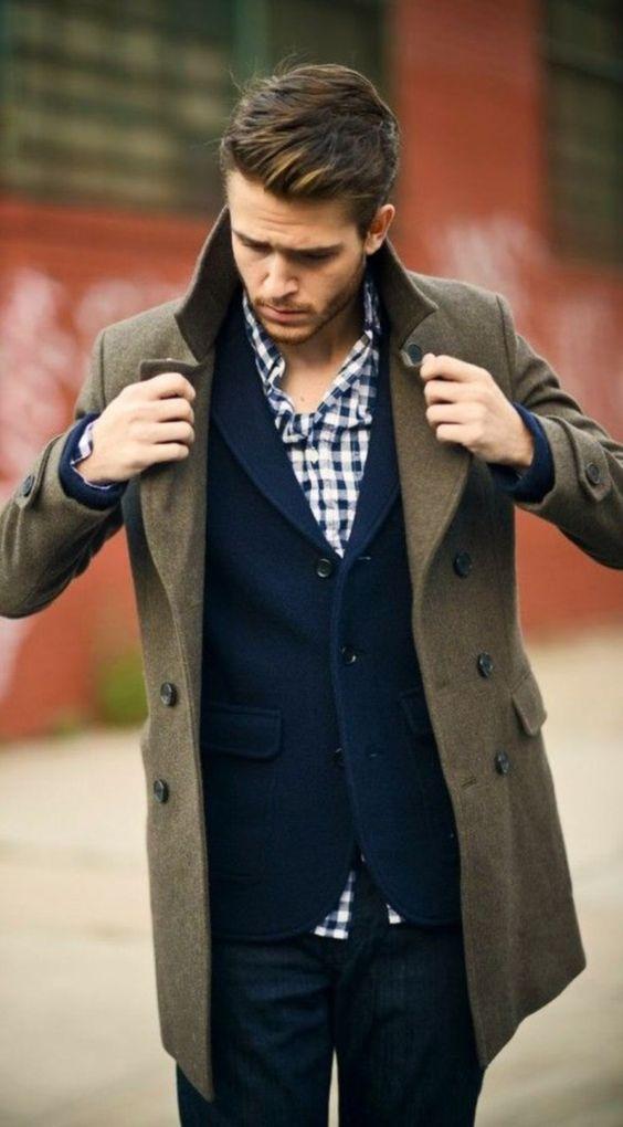 a navy blazer, dark denim, a checked shirt and an olive green coat