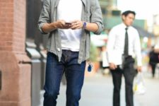 02 a white t-shirt, navy jeans, an olive grey shirt and brown shoes