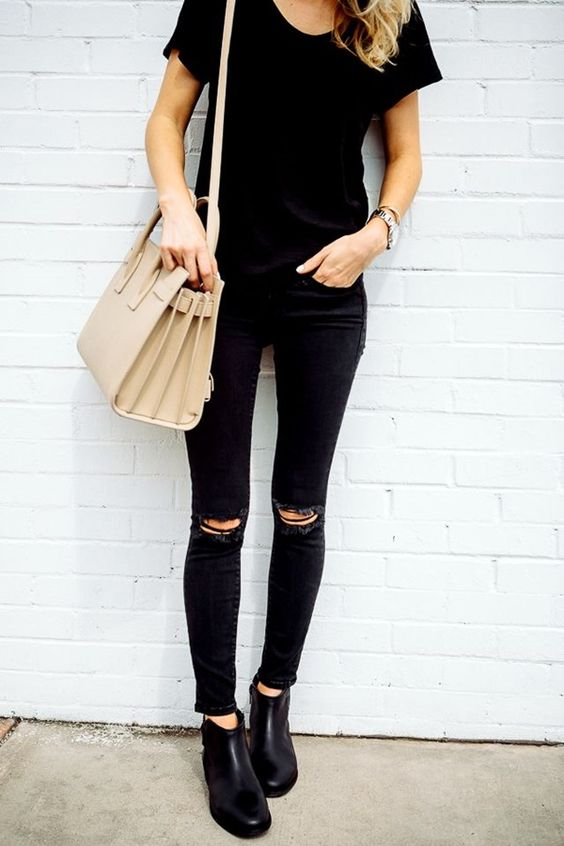 all-black look with jeans and a tee and a tan bag