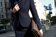 02 black suit with a skirt and a black top suits even the strictest dress code