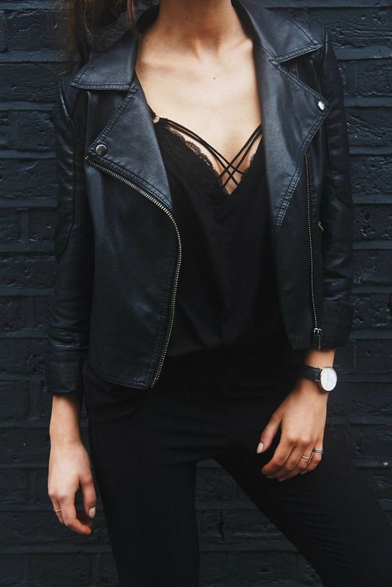 black toursers, a black lace top and leather jacket
