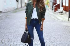 03 a green bomber jacket, a white t-shirt, ripped jeans, black ankle boots and a black bowling bag