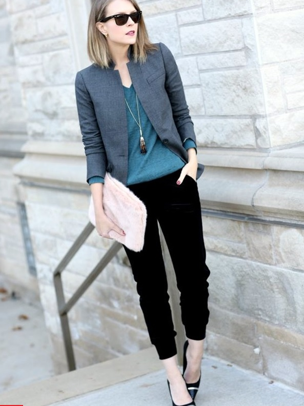 black cropped trousers, a dark green jersey, a grey jacket and black shoes