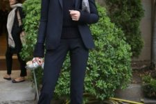 03 black suit, a black sweater, black suede shoes for a monochromatic look