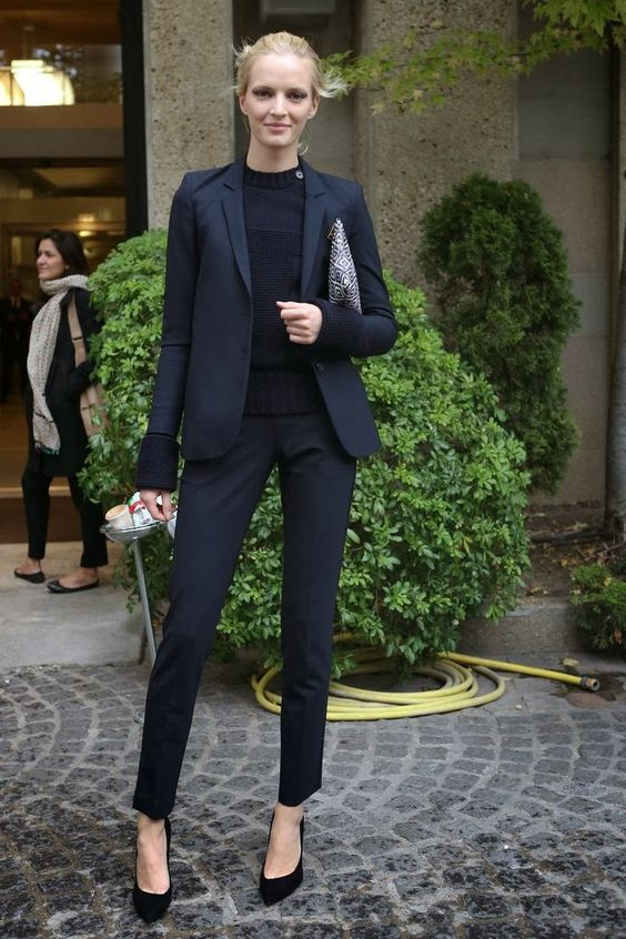 black suit, a black sweater, black suede shoes for a monochromatic look