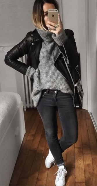 a black leather jacket, grey sweater, black jeans, and sneakers fall outfit