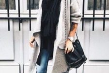 04 black loafers, blue jeans, a black top and scarf and a long grey cardigan