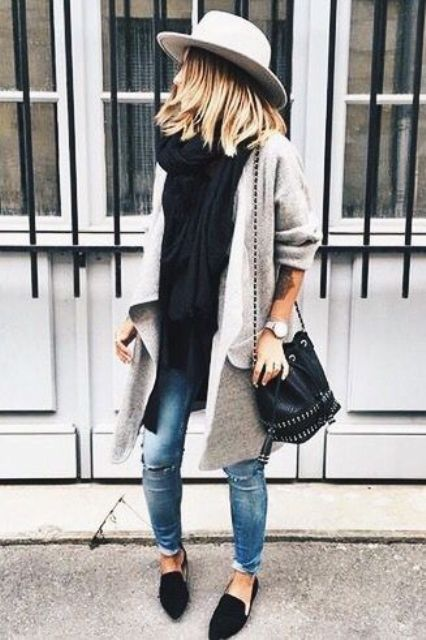 black loafers, blue jeans, a black top and scarf and a long grey cardigan