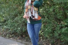 05 a plaid blanket scarf, a green sweater, skinny jeans and booties