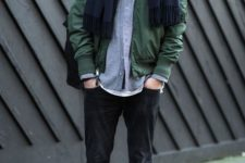 05 black jeans, a grey overshirt, an olive green jacket and a navy scarf