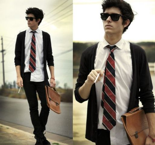 black jeans, a white shirt, a striped tie and a black cardigan
