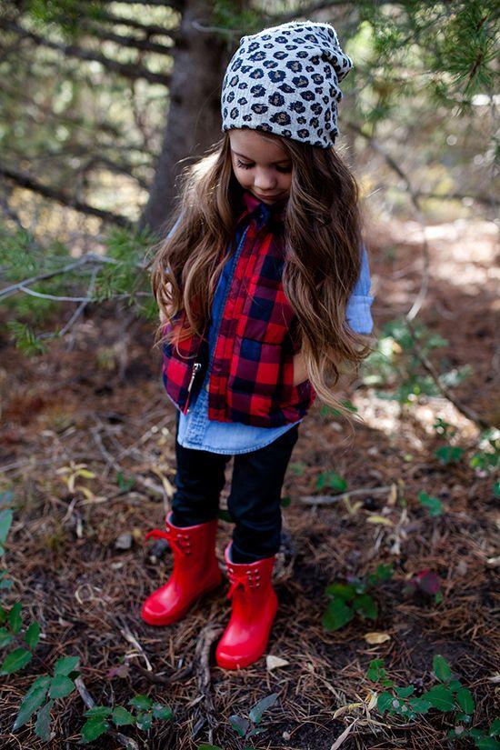 black pants, a denim shirt, a plaid vest and red boots