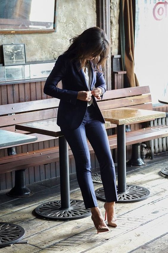 navy suit, a white shirt and nude pumps