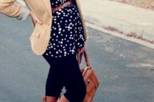 06 black jeans, a dotted flowy top, brown boots and a tan jacket