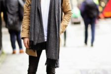 06 black jeans, a white tee, an ocher moto jacket and black boots