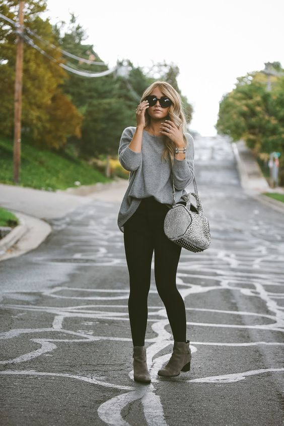 black leggings, a long grey jersey, boots
