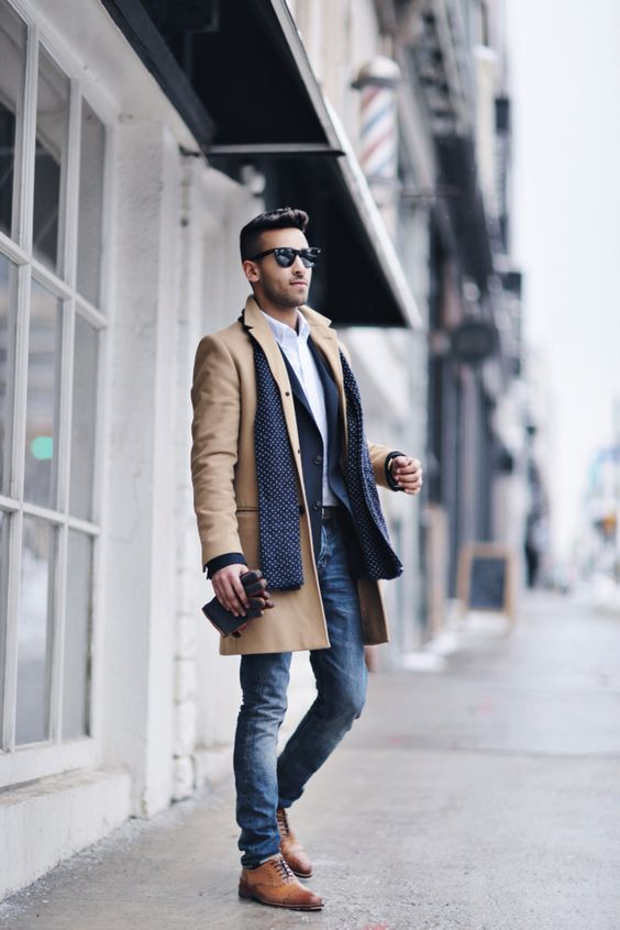 blue jeans, a navy blazer, a camel coat and ocher shoes