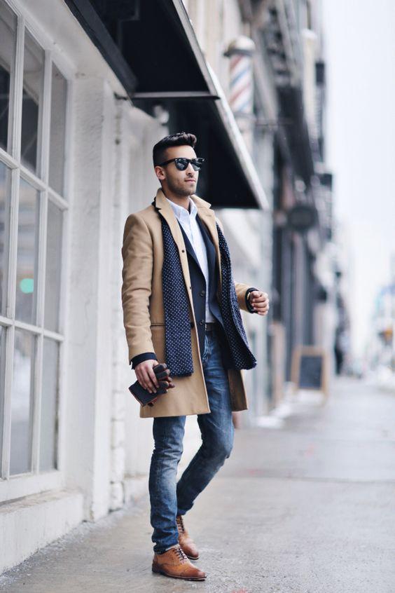blue jeans, a navy blazer, a camel coat and ocher shoes