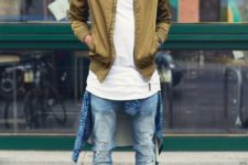 06 blue ripped jeans, a white tee, an ocher bomber jacket and grey boots