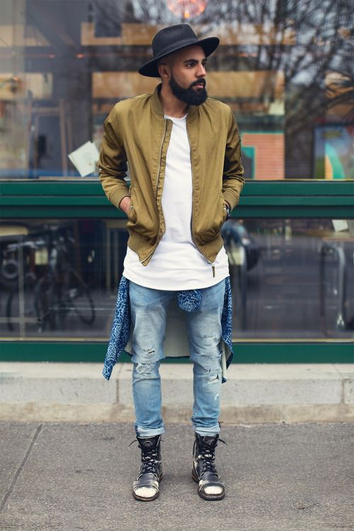 blue ripped jeans, a white tee, an ocher bomber jacket and grey boots