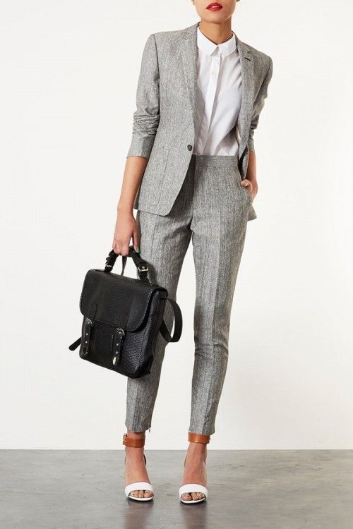 light grey suit, a white shirt and ankle heels