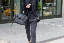 07 a black blazer and top, grey trousers and black heels