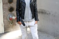 07 black sport trousers, a grey sweatshirt, white sneakers and a black leather jacket