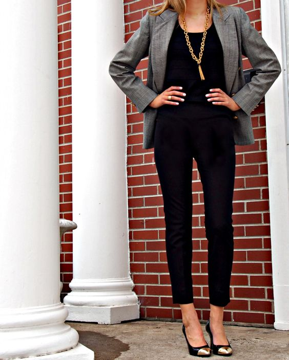 all black pants and top with a grey blazer and gold toed pointed pumps